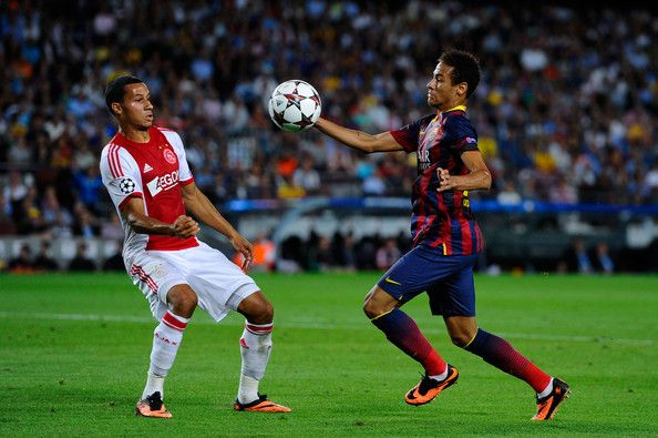 Neymar of FC Barcelona duels for the ball with Ricardo van Rhijn of Ajax Amsterdam during the UEFA Champions League Group H match between FC Barcelona and Ajax Amsterdam ag the Camp Nou stadium on September 18, 2013 in Barcelona, Catalonia.