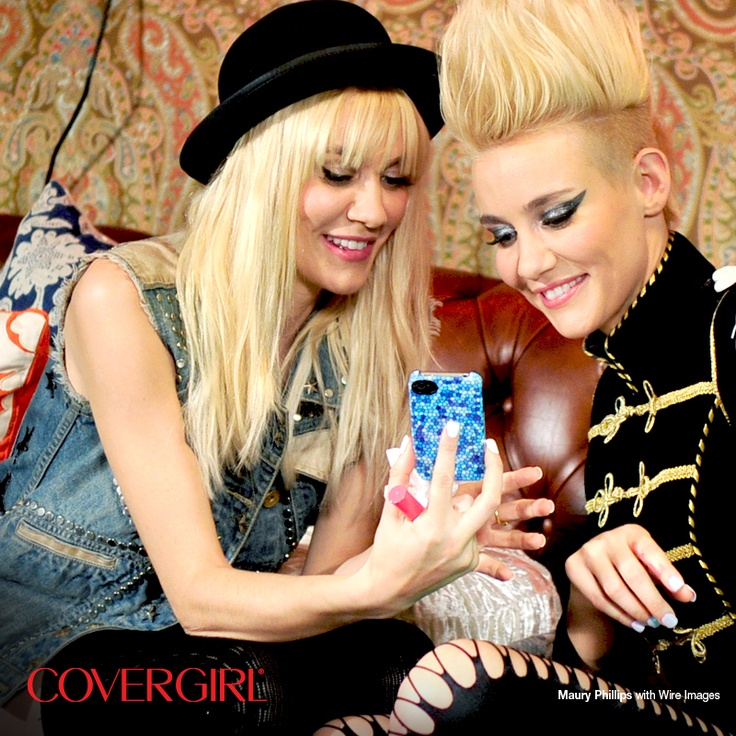 COVERGIRLs NERVO take a peek at their photos backstage at the Top DJ's Dance Party hosted by Rolling Stone.