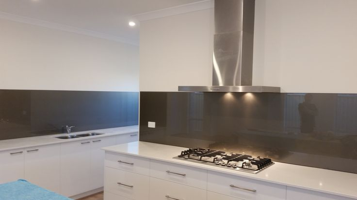 This Cappuccino glass splashback continues from the kitchen and runs throughout the scullery in this Perth new buid. www.asplashofglass.com.au
