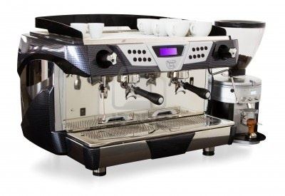 that's how a professional coffee machine looks like.  (+) pretty robust.  (+) you can adjust the pressure and everything so that you get just the perfect coffee for the beans you're using. (+) lasts forever (-) not that easy to use (for a waitress yes, but not for an occasional guest) (-) quite expensive