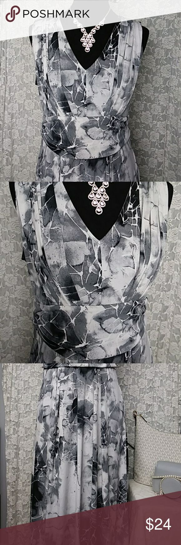 """Simply Vera Wang Marble Tie Dye Maxi Sun Dress Simply Vera Wang Size Petite Large Marble tie dye maxi dress Very elegant with pockets V neck. Sleeveless long dress From smoke and pet free home Measurments: Laying flat:  Top of shoulder to bottom hem- 50"""" Bust- 17"""" Waist- 15"""" Happy poshing, check out my closet New items added daily! Simply Vera Vera Wang Dresses Maxi"""
