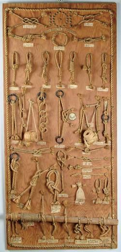 Knot Board with forty-one identified knots made from twisted hemp rope pieces. Brass stud 101 at top signifying troop number. Very well done on plywood board with rope border.