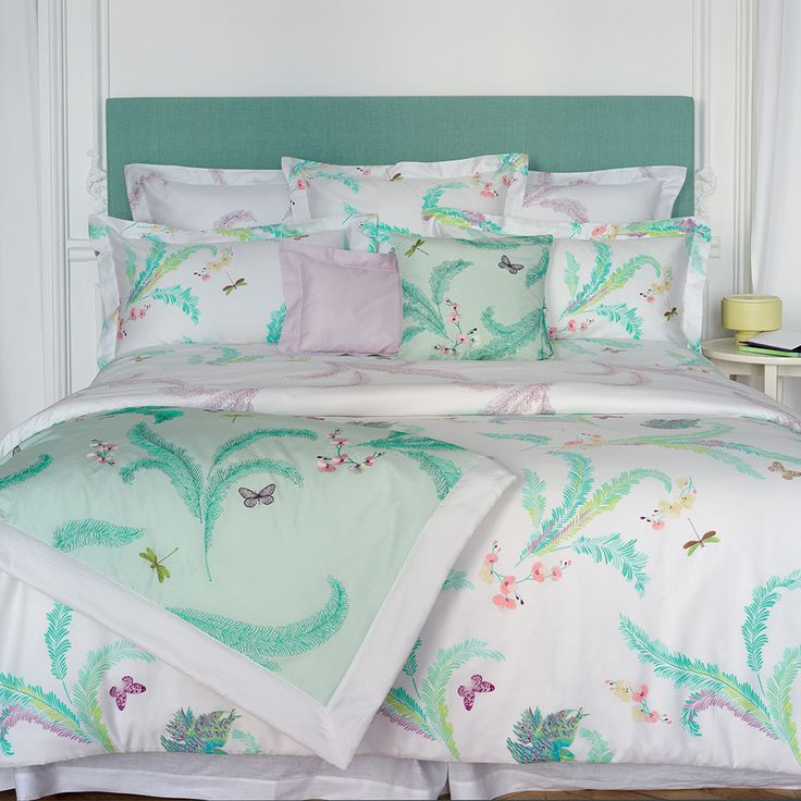 Create a luscious, tropical feel in any bed space with this Evasion duvet cover from Yves Delorme. On a fresh white background, this duvet cover is patterned with a vibrant sub-tropical design filled