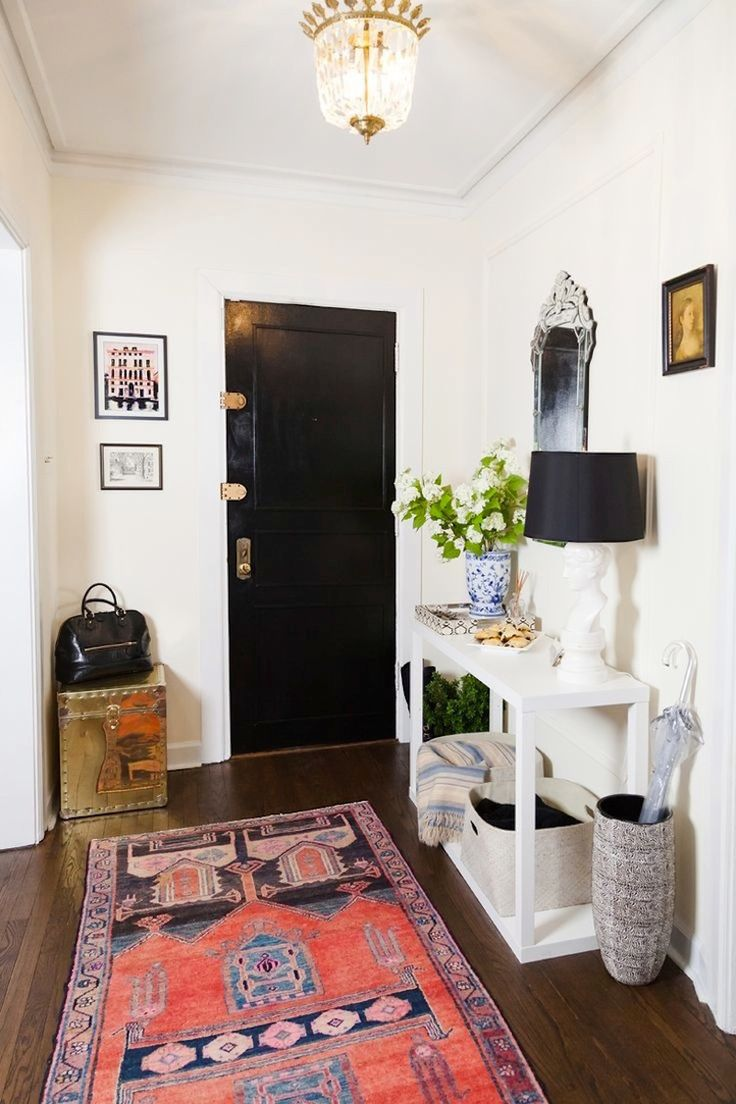 Foyer hallway lighting traditional entry chicago by tower -  Entryway With Coral Pattern Rug And Black Door What S Essential To Your Entryway