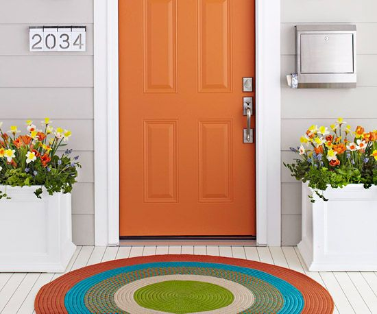 Customize Accessories  Forgo a traditional doormat for a colorful round rug that's suitable for outdoor use. PVC planters can be painted to complement your color palette, plus they are lightweight and maintenance-free.