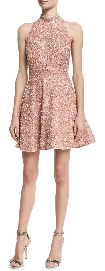 "Hollie Sequined Fit-and-Flare Racerback Dress by Alice + Olivia. Alice + Olivia ""Hollie"" silk mini dress with sequin embellishing. Mock neckline; low-cut racerback. Sleeveless; cut-i..."