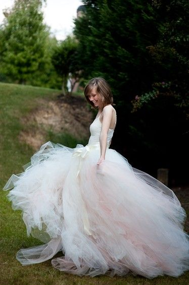 Idea: A wedding skirt with a slight hint of color...made to look full and yet uneven. Adult long tutu skirt, Adult tutu dress, Ivory with a hint of Peach Adult tulle skirt,  bridal wedding dress, sewn tutus. $395.00, via Etsy.