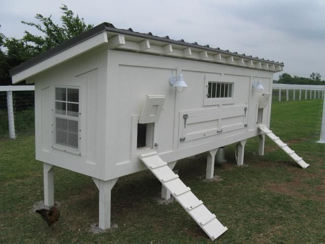I love the clean lines and white color scheme on this coop.