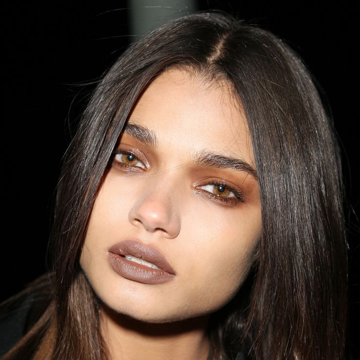 Givenchy showcased a monochromatic makeup look that included tawny, faded shadow and a matching matte lipstick.
