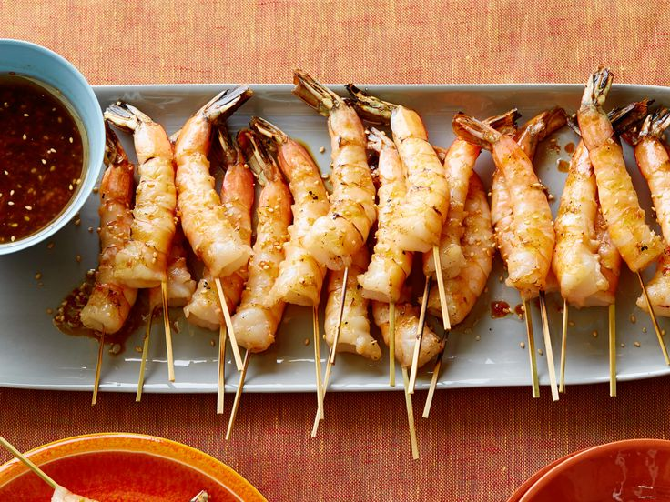 Grilled Shrimp Skewers with Soy Sauce, Fresh Ginger and Toasted Sesame Seeds recipe from Bobby Flay via Food Network