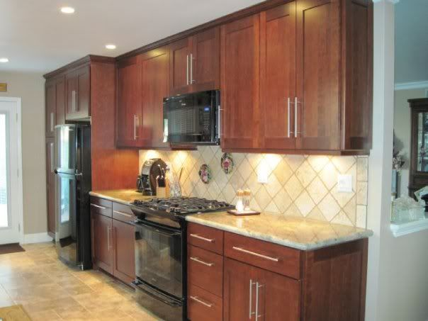Cherry cabinets with black appliances tile patterns for Kitchens with black appliances