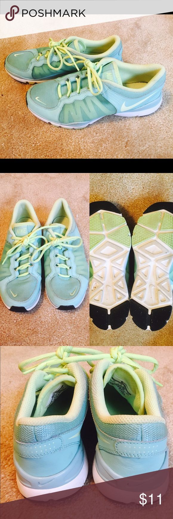 Nike Training Shoes Size 7 Shows some signs of wear, but DEFINITELY still has a ton of life left in them! Size 7, Nike Training in tealish-blue and lime green Nike Shoes Athletic Shoes