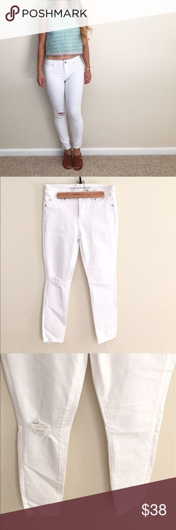 """Articles of Society 'Carly' Frayed Hem Skinny Jean Articles of Society 'Carly' Frayed Hem Skinny Jean! Women's size 27. In like-new condition. Worn white color. Frayed hem and light distress give these ankle-grazing jeans an easy-going feel. Faux front pockets. Back pockets. Approximate measurements given below:  Length: 35""""  Inseam: 26"""" Rise: 9"""" Waist: 14"""" Material: cotton/rayon/spandex Size: 27  🔸10% off bundles of 2 or more items 🔸No Trades 🔸Reasonable offers accepted 🔸Fast Shipping…"""