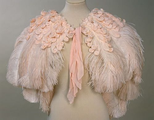 A pretty pink ostrich feather cape from 1937. I love how the feathers on top have been curled.