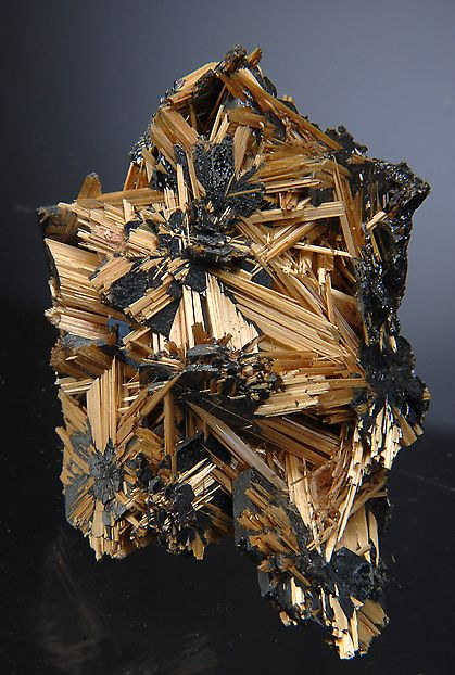 A fine example of golden Rutile sprays on metalic silver crystals of lustrous Hematite.
