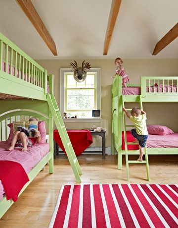 "Her great-nephews, Dexter Harris and Nolan Gillis, and great- niece, Vivi Harris (center), kick back in the ""bunk room,"" which features double-decker beds purchased on the cheap at an unpainted-furniture shop and transformed with custom paint."
