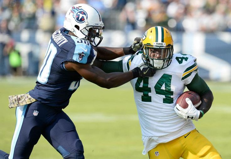 Packers vs. Titans:  47-25, Titans  -  November 13, 2016  -      Tennessee Titans cornerback Jason McCourty (30) tries to bring down Green Bay Packers running back James Starks (44) in the first half of an NFL football game Sunday, Nov. 13, 2016, in Nashville, Tenn.