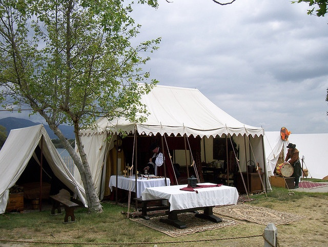 central tent with separate sleeping tents