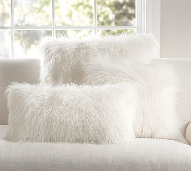 "Mongolian Faux Fur Pillow Cover - Ivory #potterybarn Love furry pillows for cuddling in winter! What are chances of finding one in teal :o) ($45/18""square) Just want to add that I love this pillow against the teal blanket that's over my gray chair! It's like petting a kitty- except it doesn't purr :o("