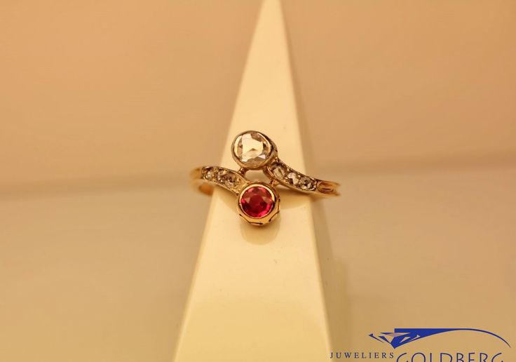 Terrific 14 carat gold antique ring with diamond and probably Spinel. It dates from early 20th century. For € 420,-. Goldberg Juweliers http://www.goldbergjuweliers.nl/en/antique-14-carat-gold-ring-with-rose-cut-diamond.html