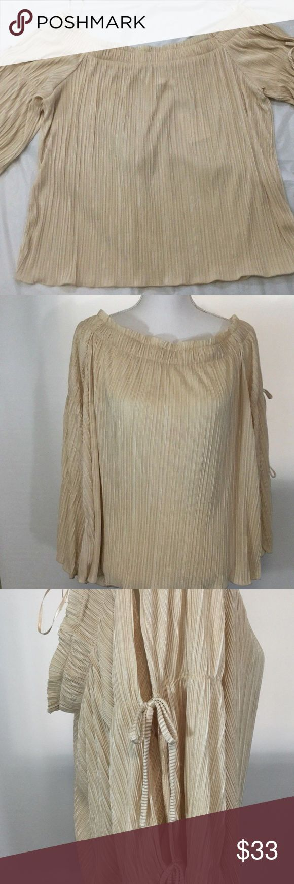 Lauren Conrad Womens Blouse XXL Cold Shoulder A beautiful Lauren Conrad Ladies Off the shoulder style Blouse size XXL  The sleeves are a split style  It is a light tan or ivory color  Please see all of the pictures and ask any questions that you may have  The blouse measures approx.. 25 inches across the chest laying flat not stretched out  It is 21 inches long LC Lauren Conrad Tops Blouses