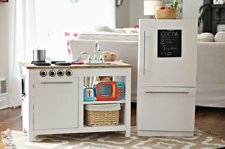 Farmhouse style kitchen set for kids complete with fridge and freezer, oven, sink and plenty of storage for hours of imagination and play time!