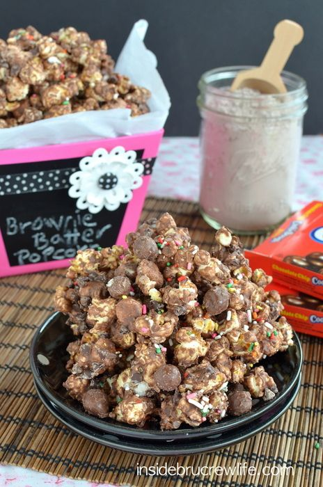Chocolate covered popcorn that tastes like brownie and fun cookie dough chunks. You will not be able to stop eating this. #popcorn #recipe #cookiedough #chocolate
