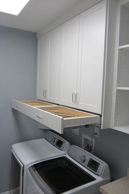 OMG! I love that drying rack drawer!! Laundry Room Cabinet Ideas | Get Laundry Room Solutions Closet Factory