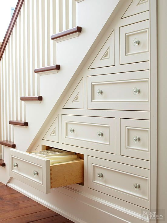 Think about what you could store in a wall filled with drawers! Table linens, fine china, candles, serving platters, and so much more. Custom-sized drawers take advantage of every inch of space beneath this staircase. Recessed-panel fronts and shiny glass knobs give the unconventional configuration traditional appeal.