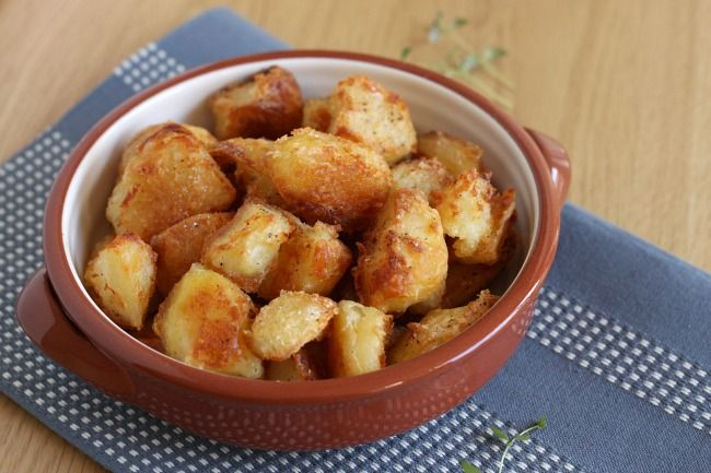 This recipe makes the perfect roast potatoes! These roast potatoes, with fluffy middles and crispy edges, are definitely worth the effort!