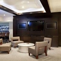 Sports Suite basement with multiple tv's