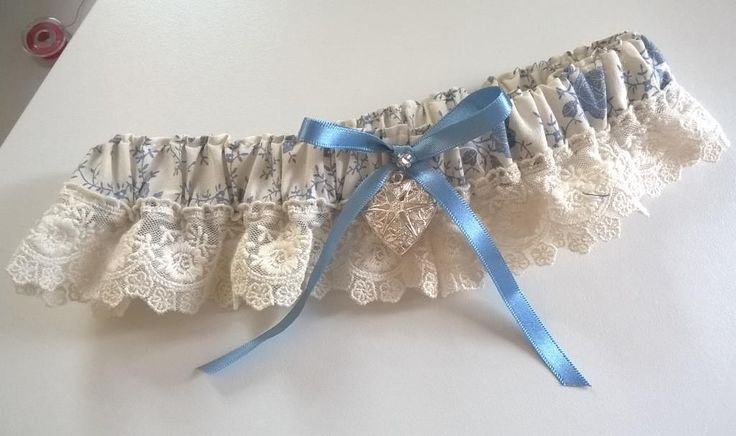 Soft printed cotton garter with antique lace and silver locket detail handmade by Beautiful Unique
