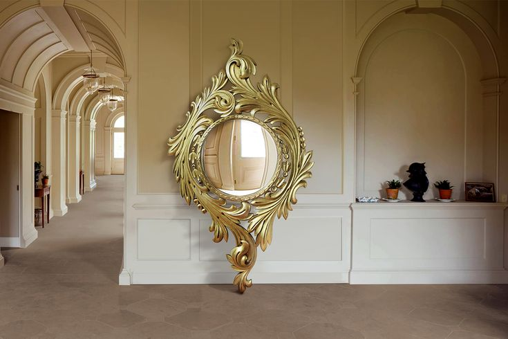 Evora Floor Mirror - Malabar | Laurel wreaths have long been used as a symbol for victory, and in ancient Roman times were for crowning commanders and victors in battle. The Evora mirror is a Rococo-style carving of a gilded laurel branch, with a circular panoramic mirror at the center. The intricate etching of the branches is gold coated to look as though Evora was taken from the richly adorned walls of centenary churches. The classic Evora mirror is a definite statement piece, totally…