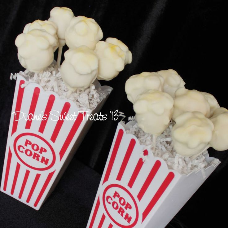 popcorn pops  Cake pops that are supposed to resemble popcorn - to go along with the carnival themed first birthday cake.