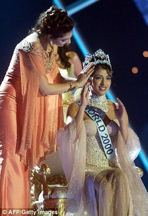 Priyanka Chopra (R) of India is crowned by Miss World 1999, also from India Yukta Mookhey ...