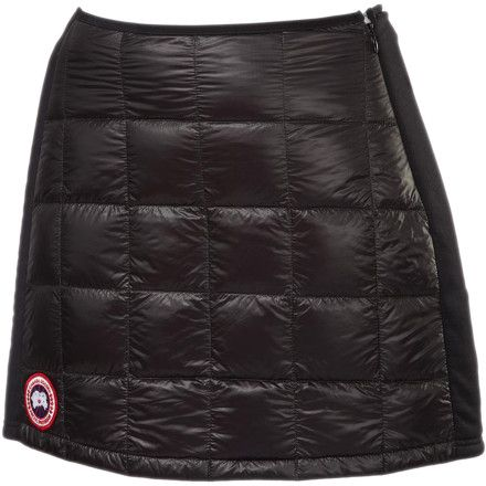 Whip the compact Canada Goose Women's Hybridge Lite Down Skirt out of your pack whenever your legs need a little extra warmth. Quilted with premium 800-fill down insulation, the Hybridge Lite brings the warmth without the weight and compresses to fit in packs filled with hiking, camping, climbing, and skiing gear without a problem. Canada Goose made this skirt out of a durable Feather-Light fabric that definitely lives up to its name, and Tensile-Tech side panels ensure excellent stretch ...