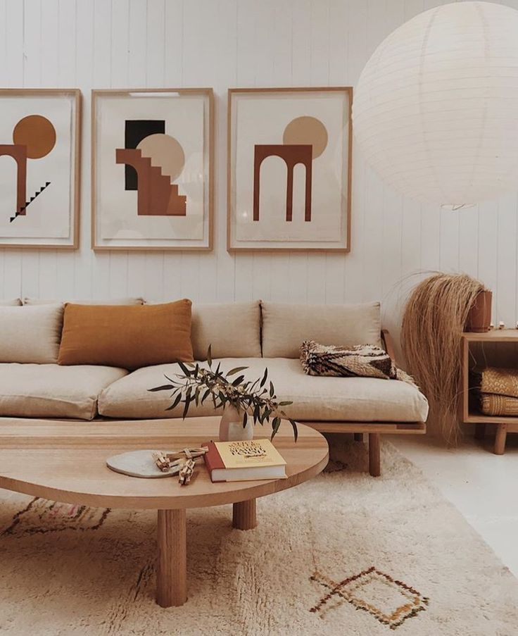 warm neutral interior, wooden coffee table, cream sofa, burnt orange cushion
