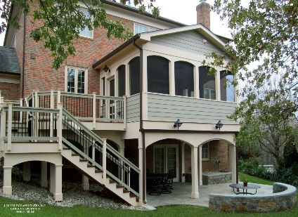 Second story screened in porch and deck with flagstone patio.  http://jbuckleyinc.com/Porches.html