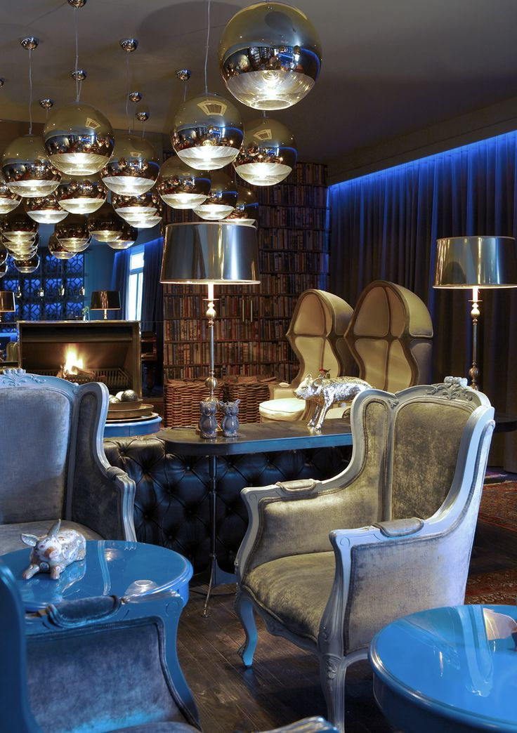 Boutique hotel | Lounge | high gloss blue | Gold pendants | Moody | Fireplace | Etienne Hanekom Interiors
