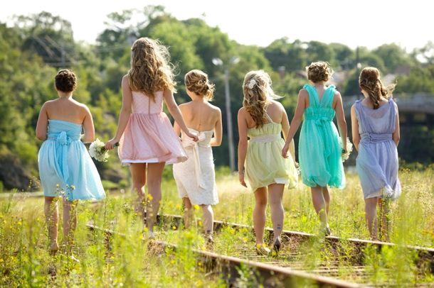Dave Welsford via littlebirddee | ice cream pastel mismatched bridesmaid dresses #wedding #bridesmaids