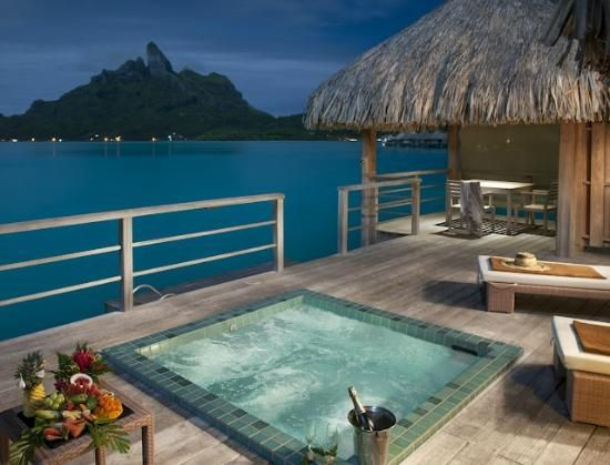 The St. Regis Bora Bora Resort: Premier Overwater Villa Terrace.  Would be great for a romantic place to visit.