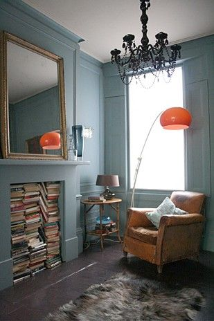 DAVE COOTE DESIGN. Love the paint color, the lamp, the books, and the leather club chair.
