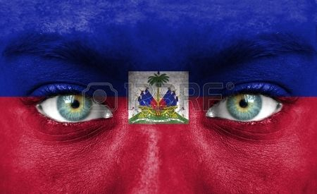 Human face painted with flag of Haiti