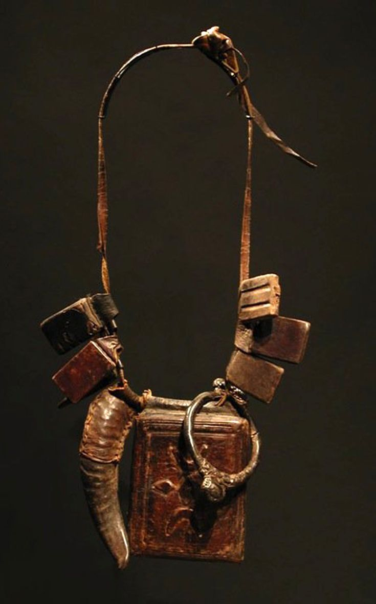 West Africa | Talisman necklace from the Fulani people | Leather and metal