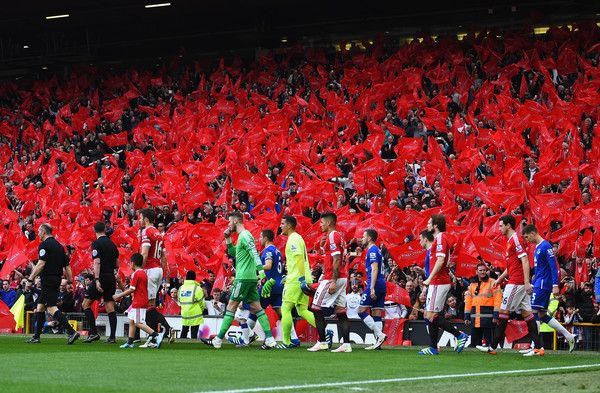 Players and officials wal onto the pitch prior to the Barclays Premier League match between Manchester United and Everton at Old Trafford on April 3, 2016 in Manchester, England.