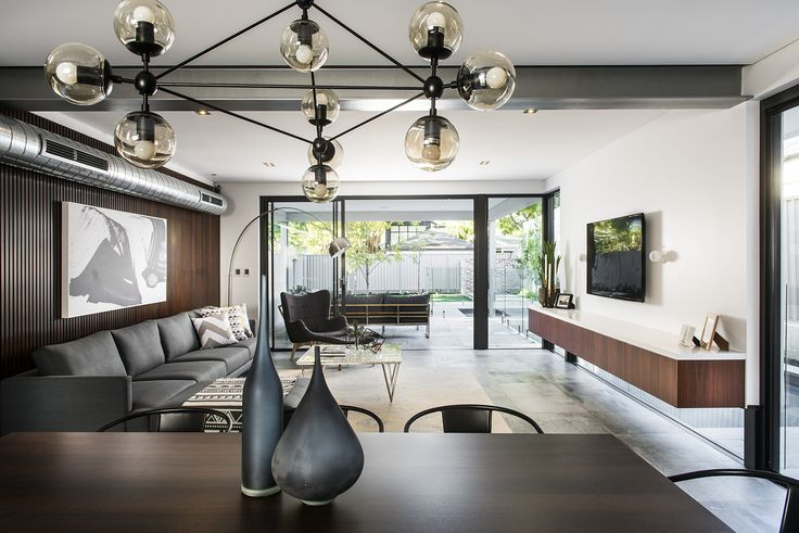 Steel, greys and blacks paired with whites and timber create the perfect contrast between industrial and warmth.