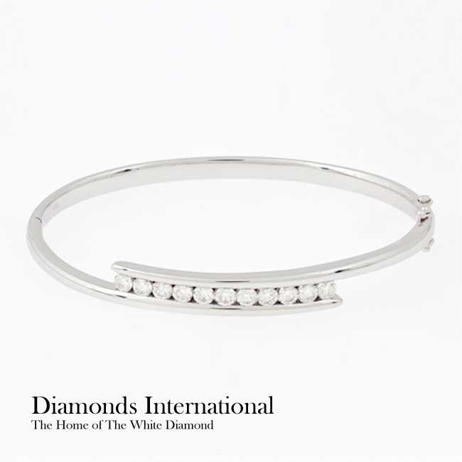 18ct white gold Diamond set hinged bangle 11 x Round Brilliant Cut Diamonds = 1.10ct - channel set. Product Reference G6688. #diamondsinternational #brisbane #jewellery #australia #gift #party #accessory #diamond #bracelet #white #bangle #gold #hinged #channelset #roundbrilliantcut #gift #wife #wedding #engagement #happy
