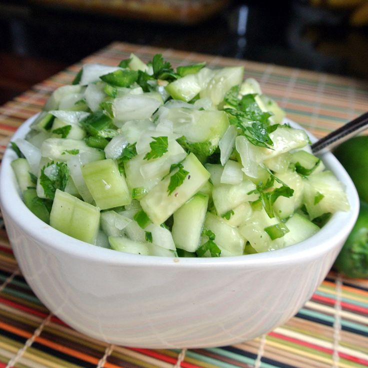 Cucumber Salsa  I can never get enough cool crisp side dishes. Give me some mason jars and fresh produce and I will fill them with as many salads, salsa's and dips as possible. Since Cucumbers are my absolute favorite, this dish hit the spot. Where we live in Southern California, one of the most popular dishes are fish taco's. This salsa goes SO nice with fish taco's. It is also good on it's own.