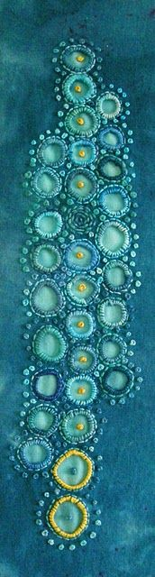 turquoise circles...beautiful stitching...this website has a long list of wonderful textile and fiber art blogs.