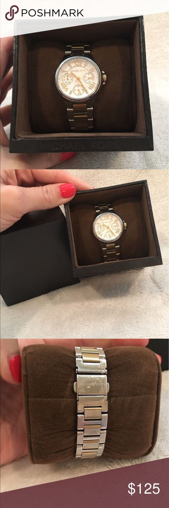 Michael Kors Gold and Silver Watch Michael Kors Gold and Silver watch. Comes with extra links, box, and original tags. Gently used. Some wear on color on the band as shown in picture. Michael Kors Accessories Watches